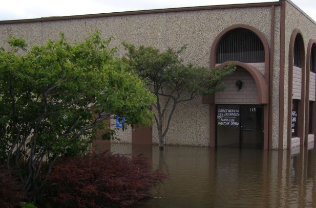 A building partway submerged in water